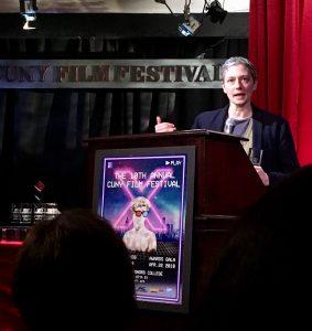 Farinella speaks at podium CUNY award