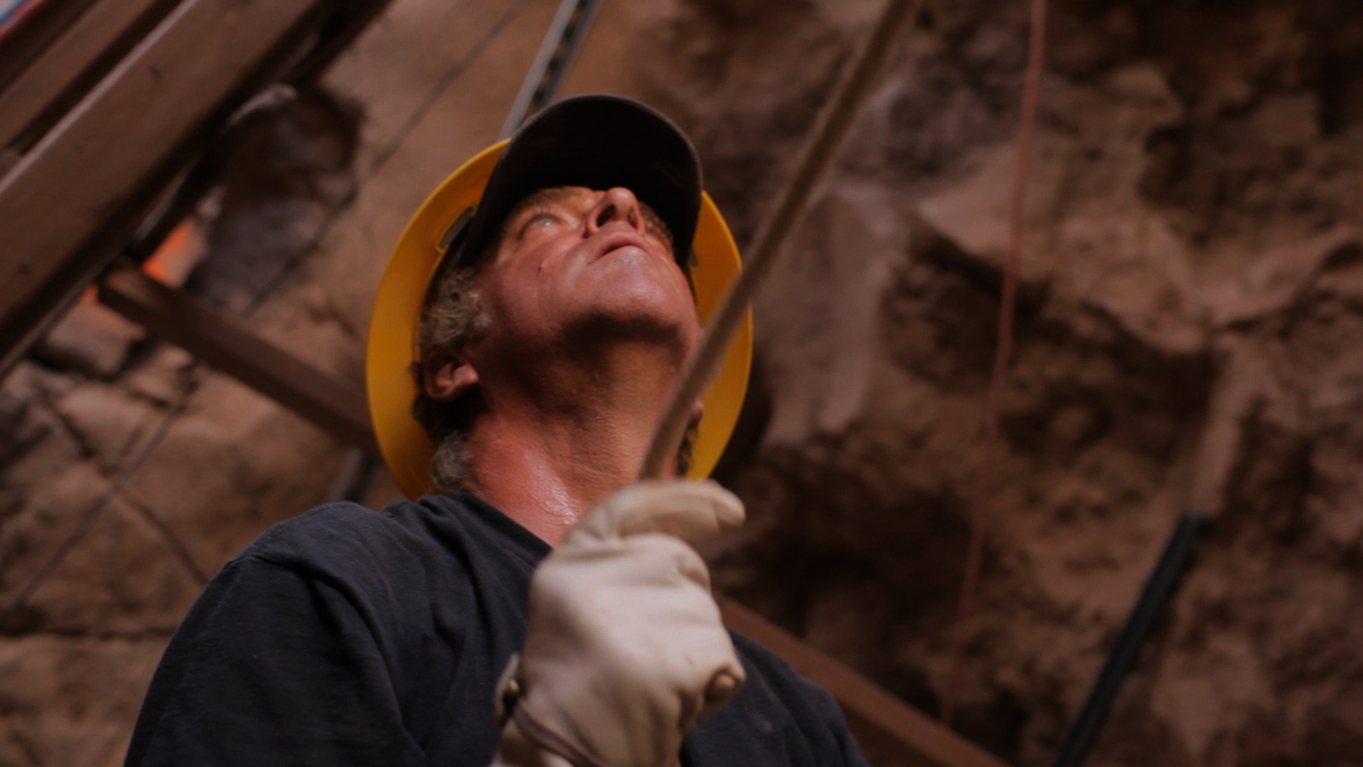 photo of a man working with a hard hat