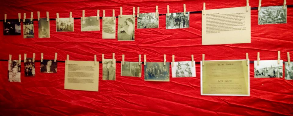 A photograph of two lines with photos hanging from them