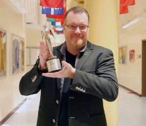 Thomas Seymour holds award