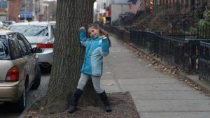 UNSTUCK film image of girl standing on street