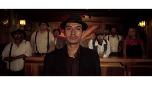 Bisbee film still - man with hat