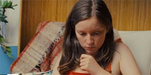 Screenshot for Jonny Come Lately with a woman looking down