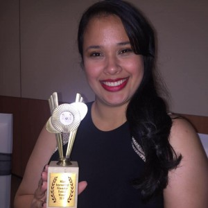 Jenn Gomez with an award