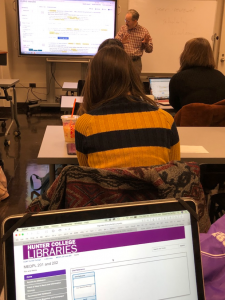 Hunter College librarian Tony Doyle teaching Sissel McCarthy's Reporting and Writing 2 students on research tools from the library.