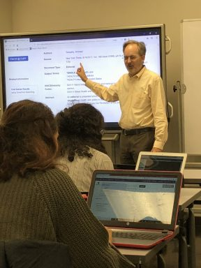 Media studies librarian Tony Doyle takes Macaulay honors students on tour of research resources for their News Literacy course.