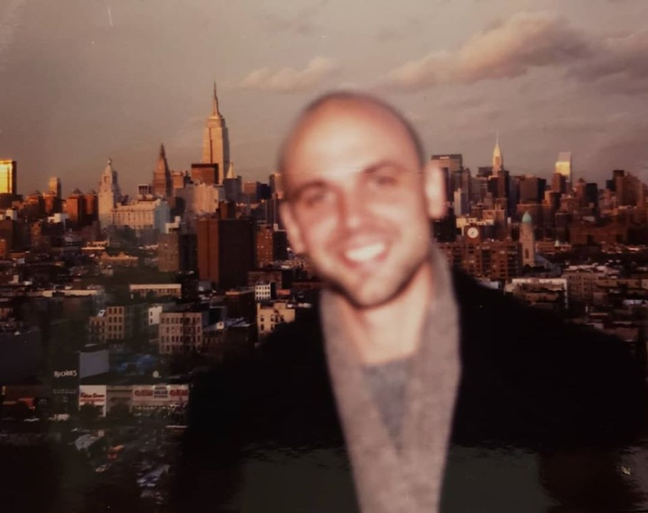 Author David Alm from the terrace of his first apartment on the Lower East Side, 1999.