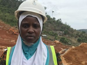 Musu Jabbie, survivor of a deadly landslide in which she lost her husband and sister, shown doing remedial work at the same site, Sugarloaf Mountain in Sierra Leone, during the commemorative tree-planting ceremony. She was photographed by Pulitzer fellow Kadia Goba during her summer 2018 reporting trip there.