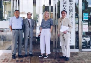 Pulitzer Center fellowship winner Audrey Henson on her reporting trip in Japan last summer, with officials from a dementia support group.
