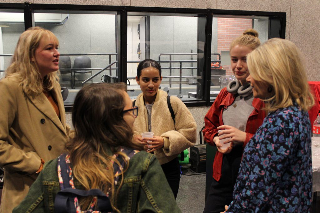 At the Oct. 23 journalism pizza party, Journalism Program Director Sissel McCarthy (far right) chats with students (clockwise from front) Gabriella Vetrano, Audrey Henson, Rebecca West and Emilia Nygren. PHOTO: Kalli Siringas
