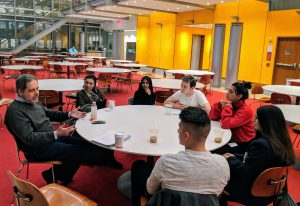 Ken Nelson of the New York Times (at left) speaks with students of the journalism program's Neighborhood News class.