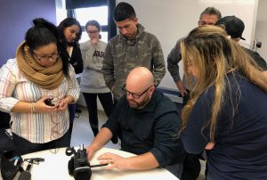 CNN photojournalist Jonathan O'Beirne (seated) with students from Prof. Sissel McCarthy's Studio News Production class.