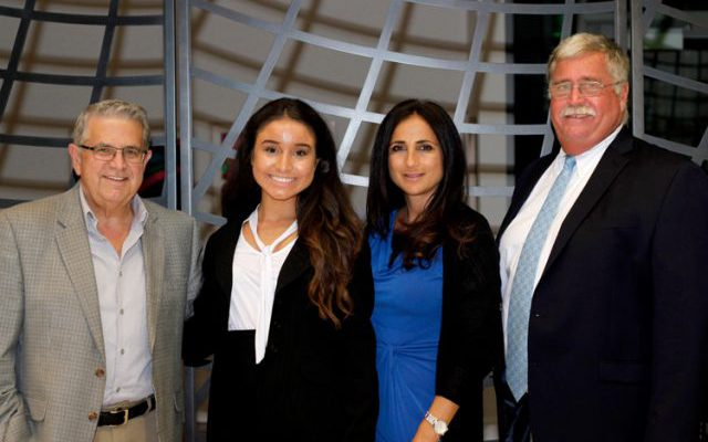 Briana Panetta (second from left), during a scholarship awards program with her mother (at her left) and two news executives. Photo: Stony Brook University School of Journalism