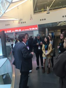 Bloomberg financial news journalist Rob Urban (left) tells Hunter students about the company in its HQ on Nov. 9.