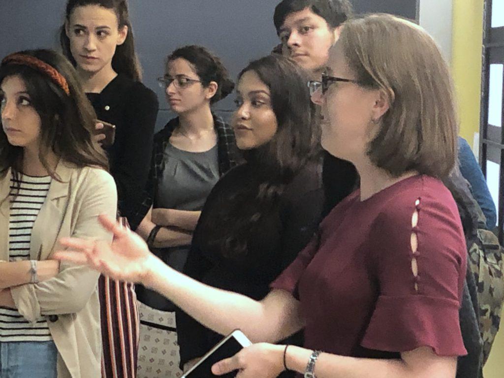 Wall Street Journal's Assistant Managing Editor Kate Ortega tours students from Katina Paron's Neighborhood News class through the news operations. PHOTO: Katina Paron